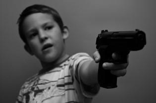 child with a gun